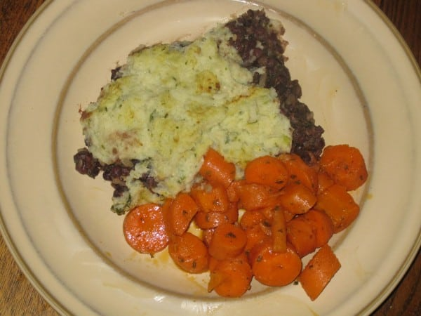 Adzuki Bean Vegan shepherd's Pie with moroccan carrots on a beige plate