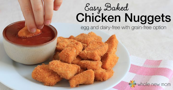 hand dipping gluten-free chicken nuggets in ketchup
