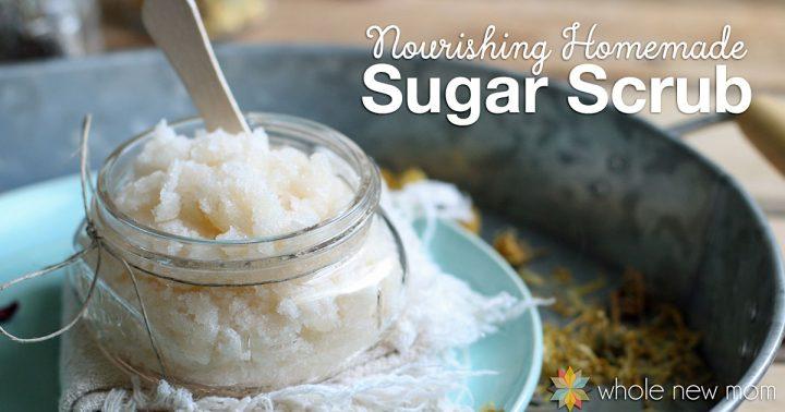 Homemade Sugar Scrub in glass jar with small wooden spatula