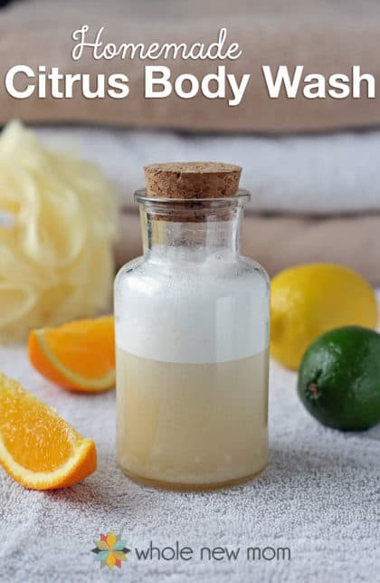 homemade body wash in bottle with towels and citrus fruits