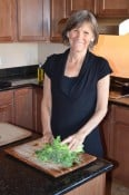 Andrea Fabry chopping vegetables in her kitchen