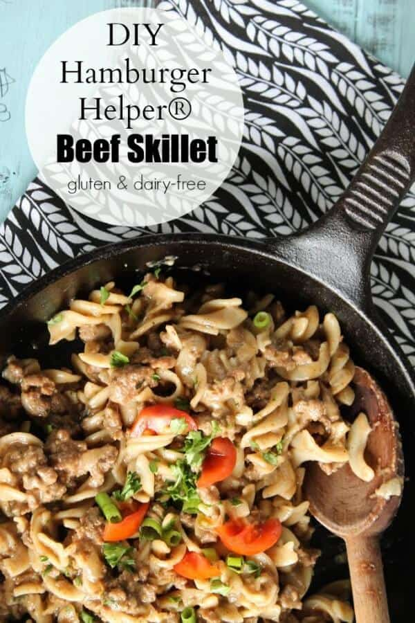 Healthy Hamburger Helper in cast iron skillet with wooden spoon