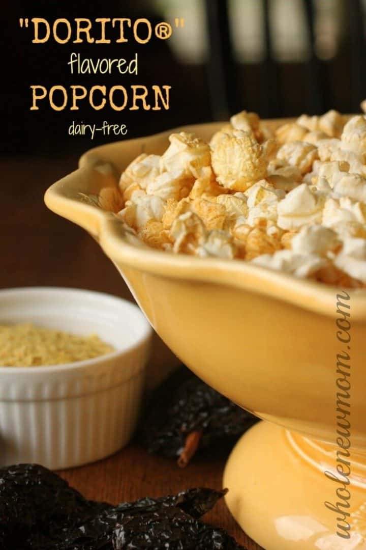 Dorito® Popcorn in yellow bowl with topping on the side