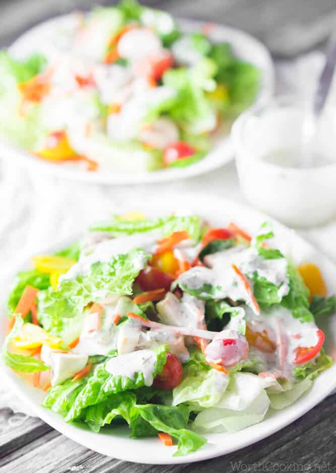 vegan ranch dressing on salad in white bowls