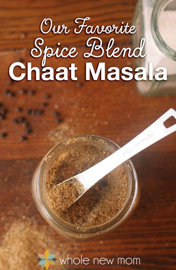 homemade chaat masala in jar with measuring spoon
