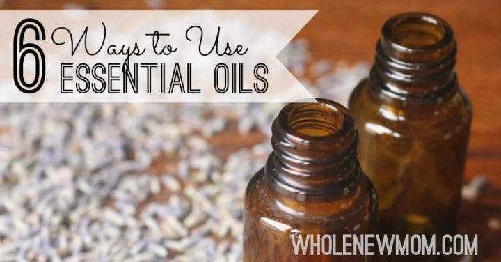 essential oil bottles with lavender in background