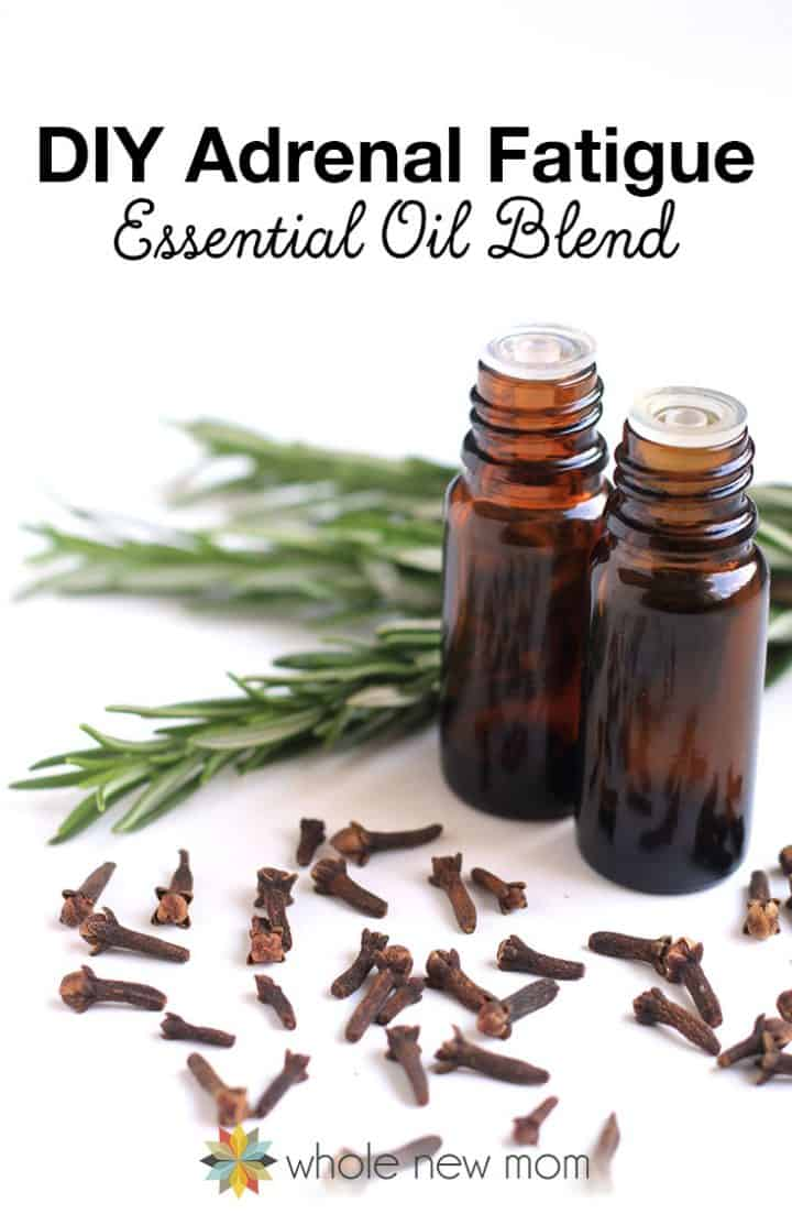 brown essential oil bottles with rosemary and cloves--essential oils for adrenal fatigue