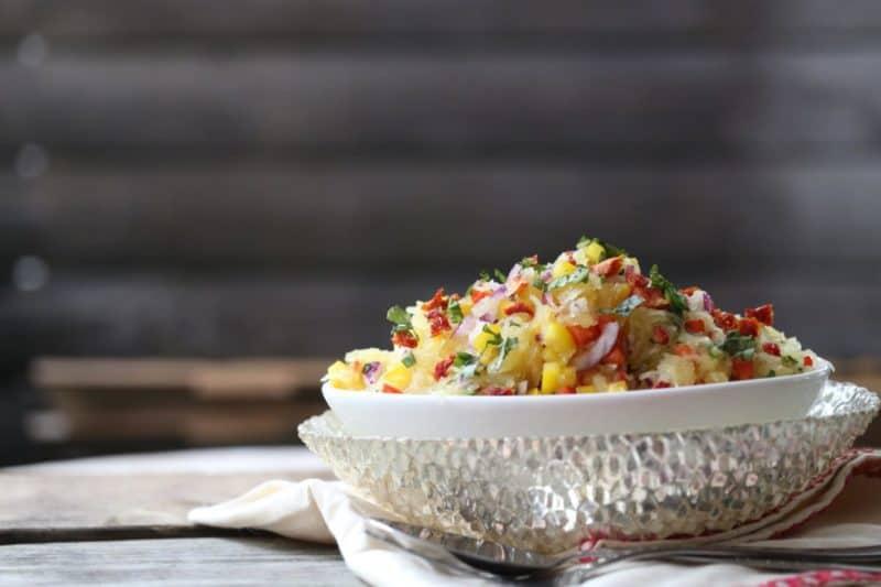 spaghetti squash salad in white bowl nested in silver bowl