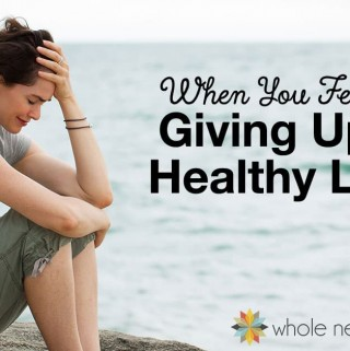 woman crying by the beach for post about giving up on healthy living