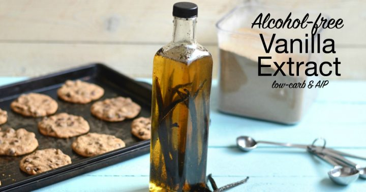 homemade alcohol-free vanilla extract in a glass bottle with baked cookies on a pan in the background