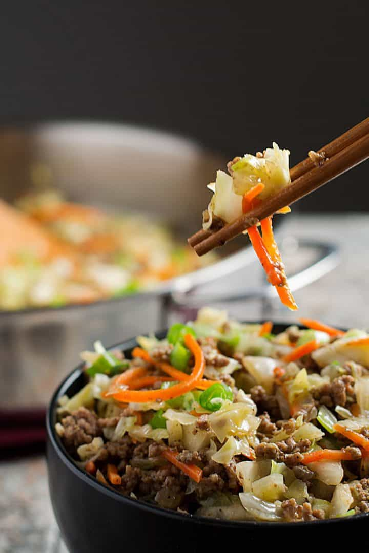 egg roll in a bowl with chopsticks