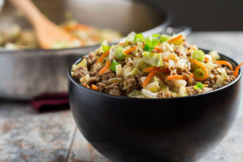 egg roll in a bowl in black bowl