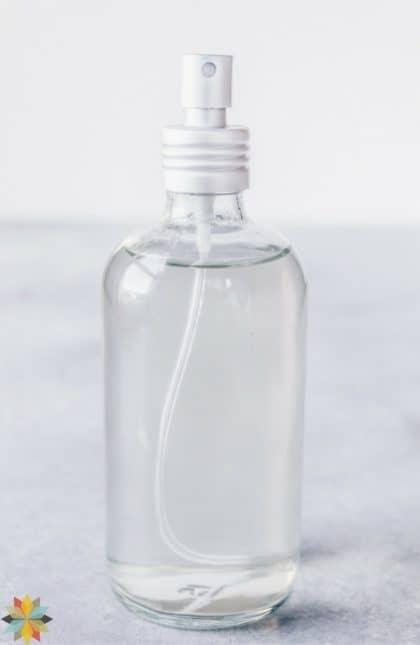 Homemade hairspray in a clear spray bottle