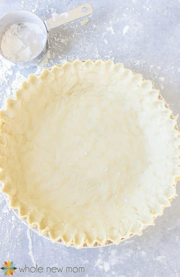 Raw Pat in Pan Pie Crust next to measuring cup