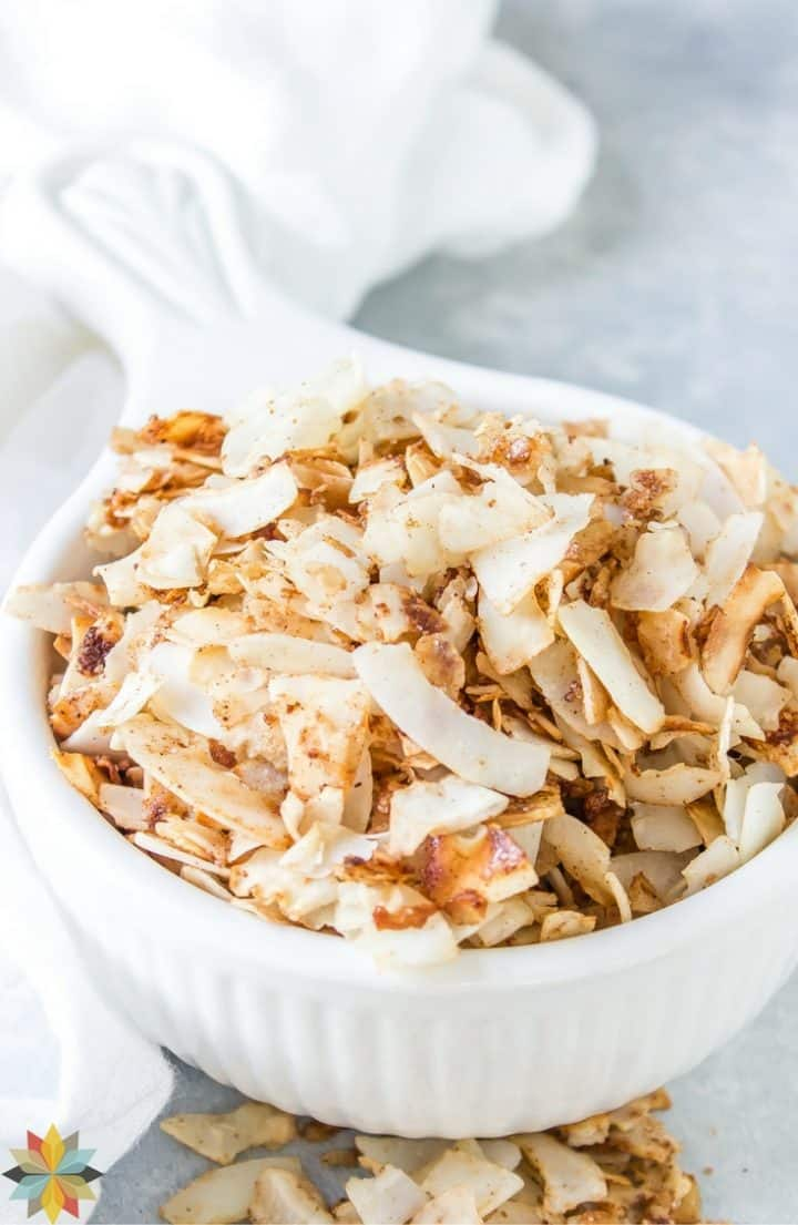 sweetened coconut chips in white bowl with handle