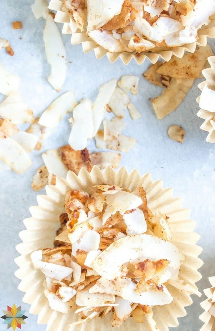 cinnamon sweetened coconut chips in cupcake paper wrappers