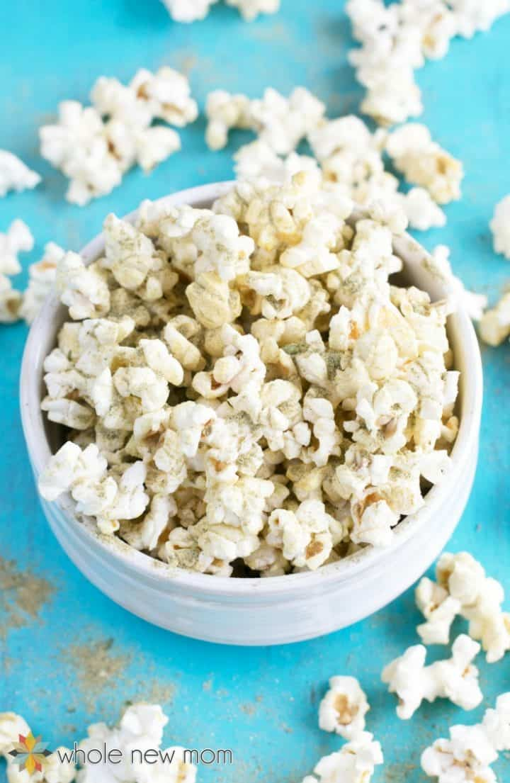 homemade popcorn seasoning on popcorn in white bowl