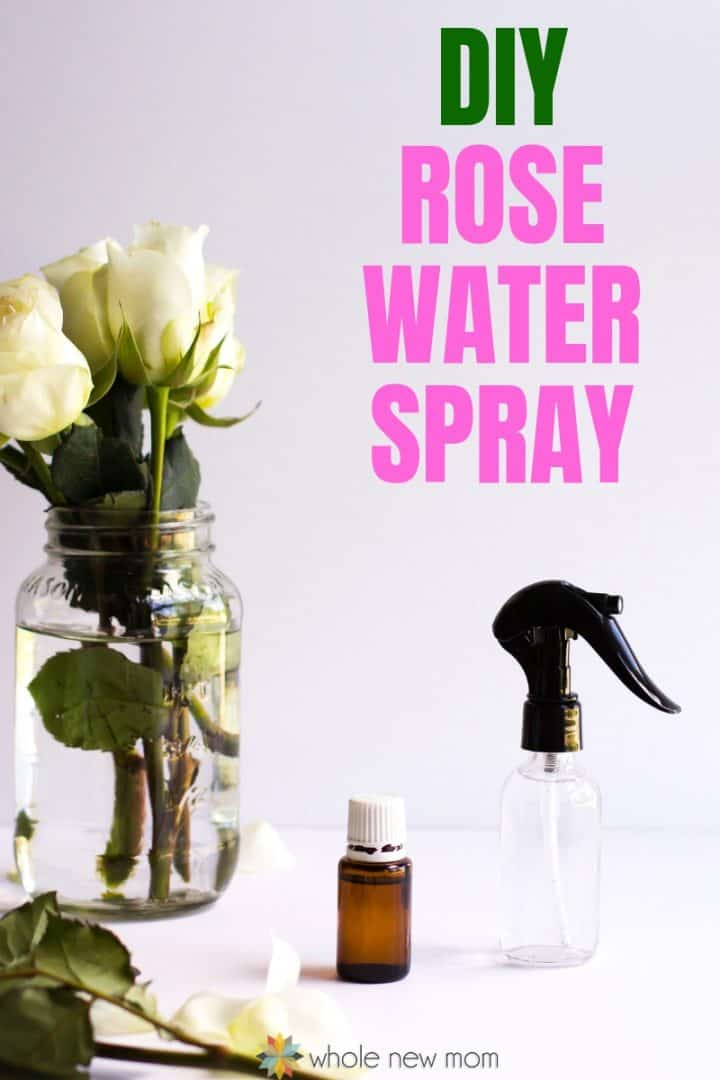 Homemade Rose Water Spray with essential oil bottle and mason jar with white roses