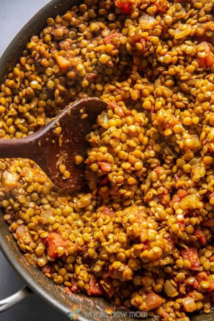 Indian Lentils in pan with wooden serving spoon