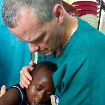 dr. stephen o'connor - emergency physician on medical mission trip with Haitian boy