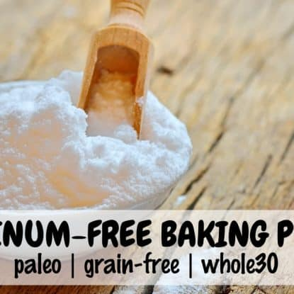 homemade baking powder in a white bowl with wooden scoop