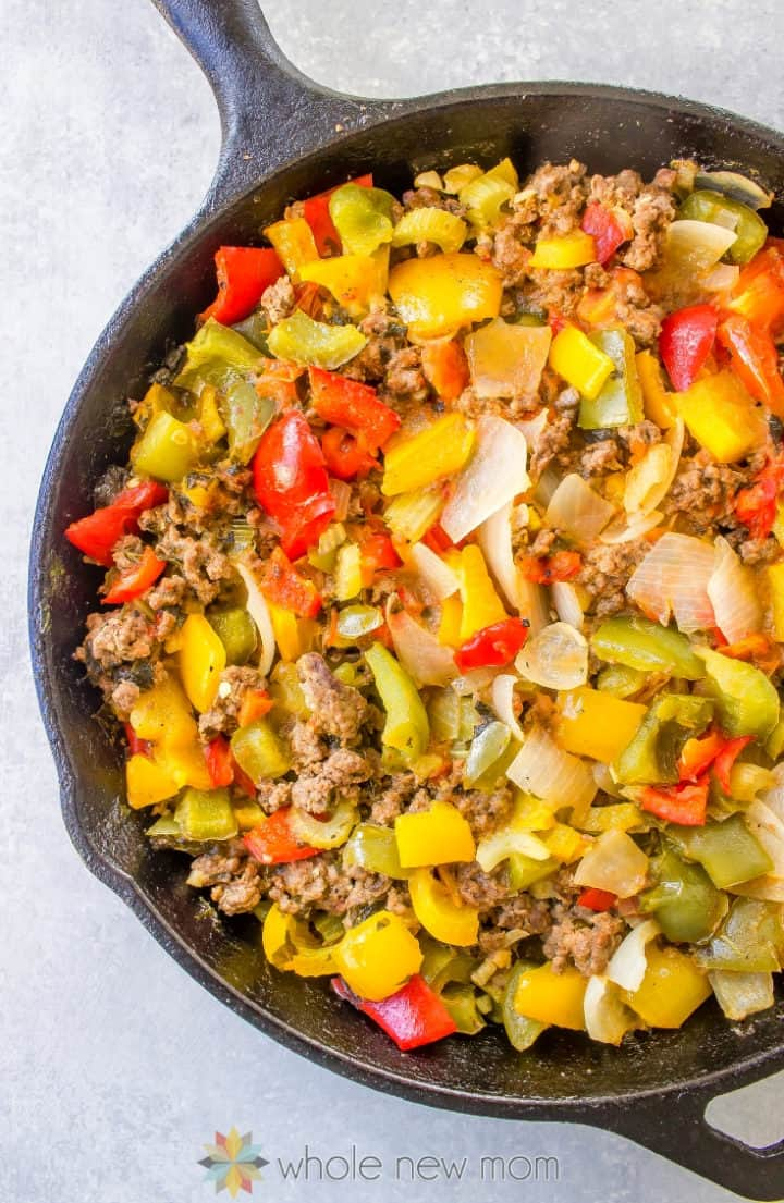 roasted vegetables and meat in cast iron skillet for paleo shepherd's pie