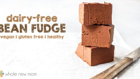 a stack of 3 pieces of bean fudge next to a knife