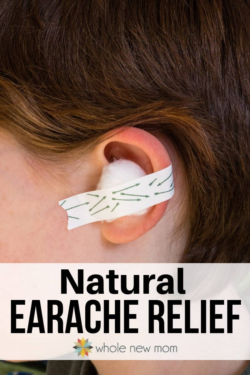 child with cotton ball and medical tape on ear for earache relief