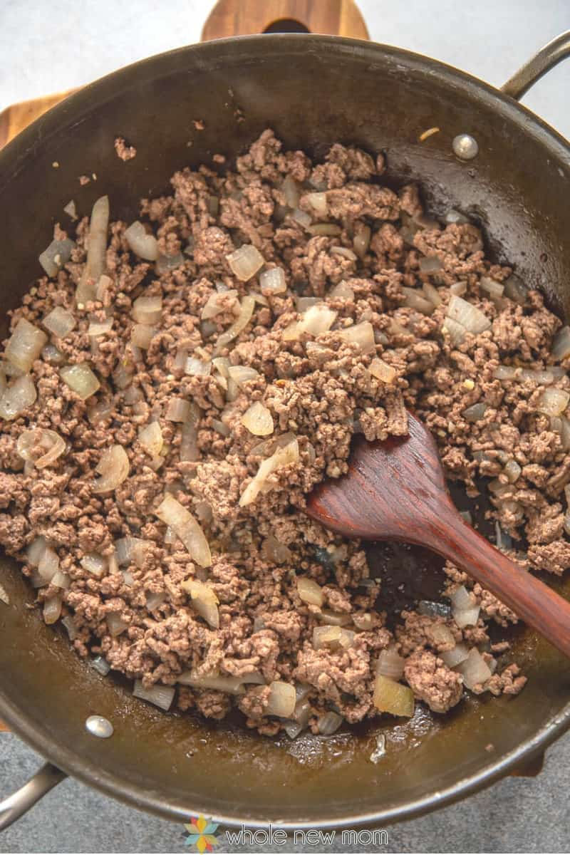 browning ground beef, onions, and garlic in pan for ground beef curry (Pakistani Kima)