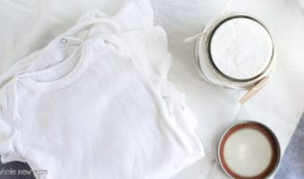 homemade baby laundry detergent with baby onesies