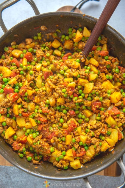 ground beef curry (Pakistani Kima) in pan with spoon