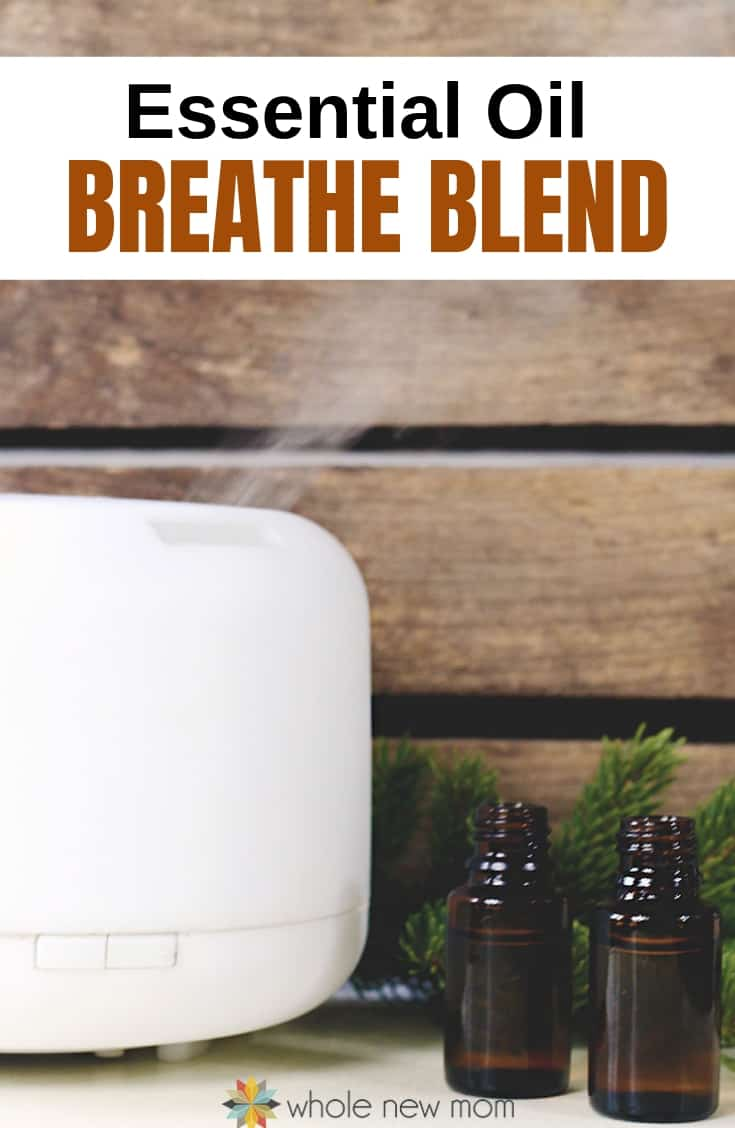 essential oil diffuser and bottles with essential oils for cough blend