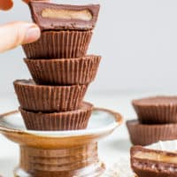 paleo almond butter cups in a pile on dessert plate