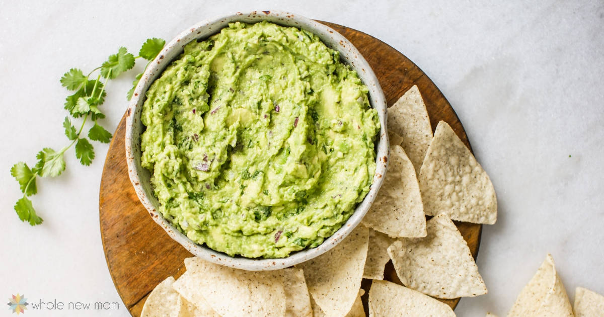 aip guacamole in white bowl with paleo tortilla chips