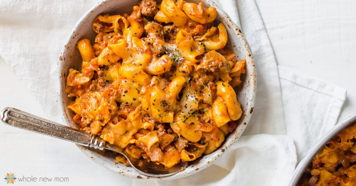gluten free chili mac in white bowl with spoon