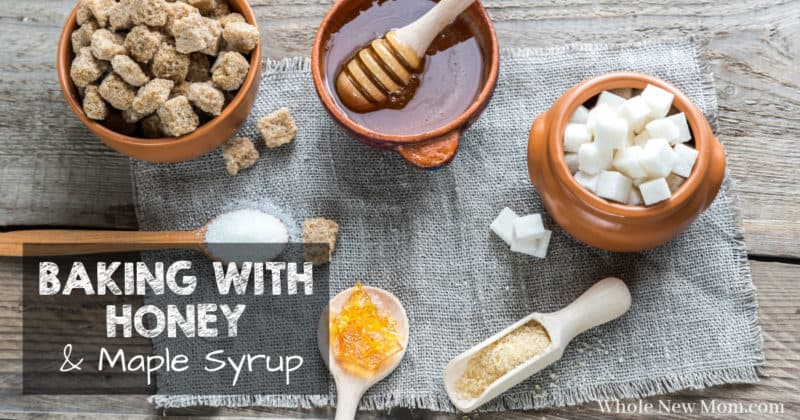 honey and different types of sugar in bowls, scoops, and wooden spoons for post about baking with honey and baking with maple syrup