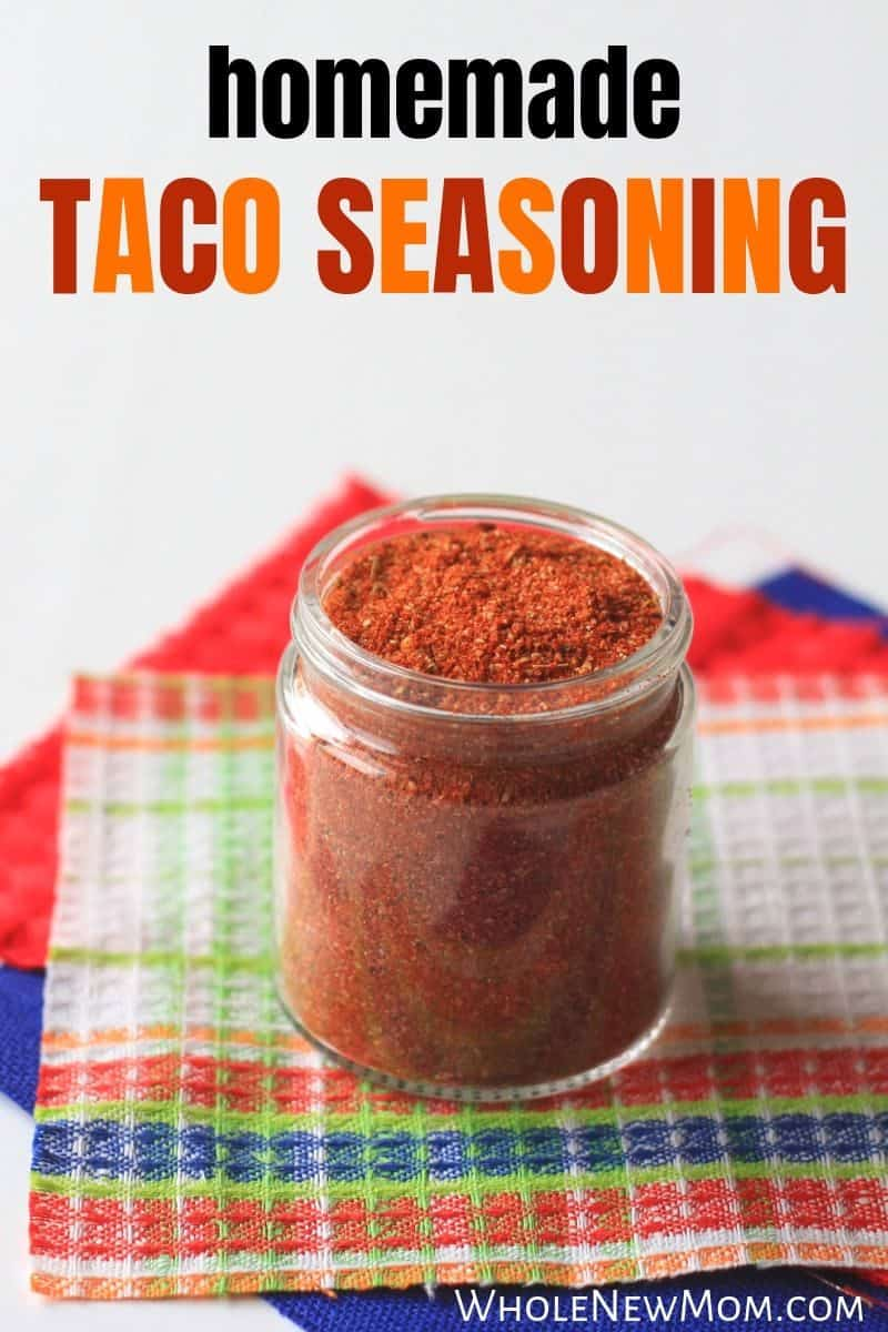 homemade taco seasoning in glass jar on top of colorful pieces of cloth