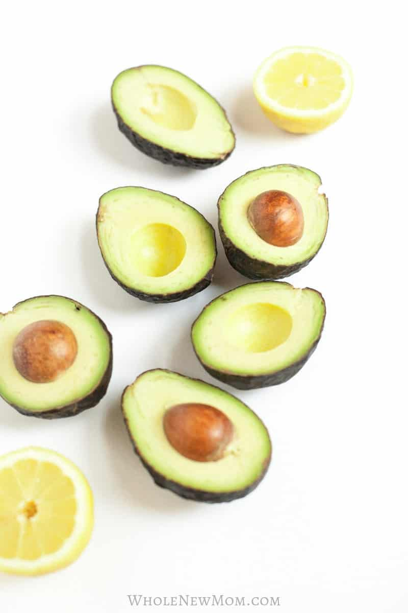 avocado halves with lemon halves for post on freezing avocados