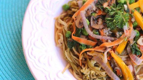 grain-free pasta primavera with eggplant noodles and vegan alfredo on a white plate
