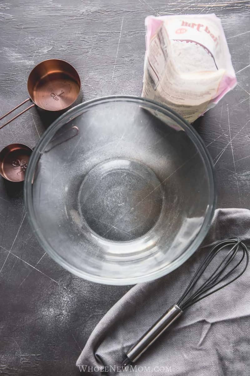 ingredients for making egg replacer powder with glass bowl and whisk