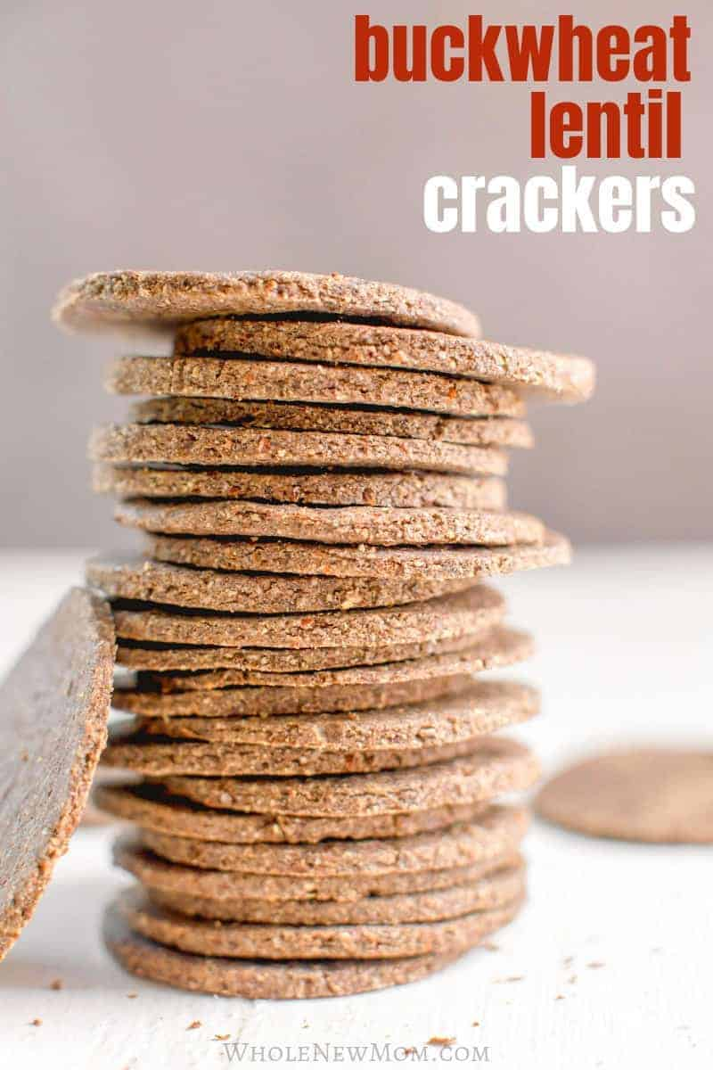 lentil crackers in a stack on white wooden table