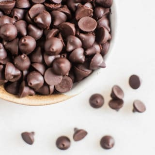 homemade chocolate chips in a bowl on a white table