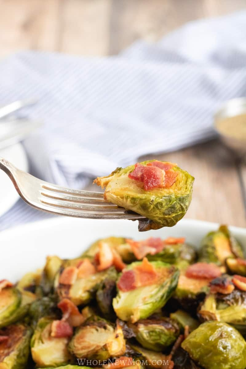 fork holding oven roasted brussels sprouts with bacon