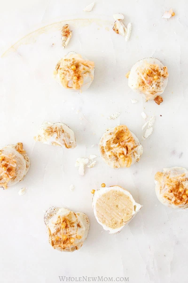 Healthy pumpkin truffles on marble tabletop - low-carb, vegan, keto