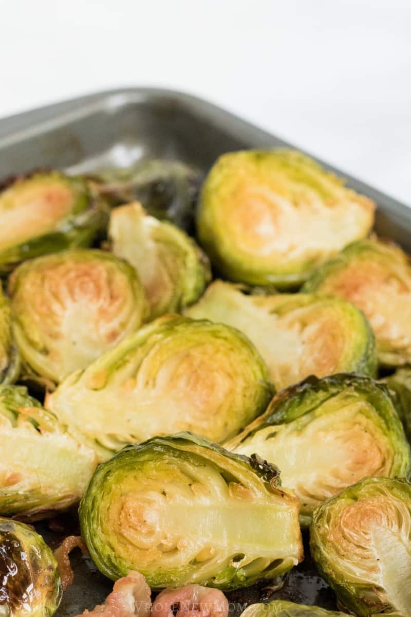 easy roasted brussels sprouts with bacon on baking sheet