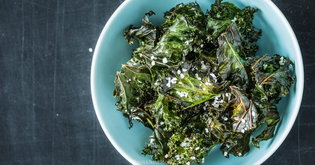 dehydrated kale chips in blue bowl