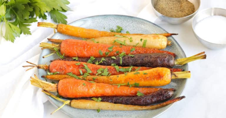 oven roasted rainbow carrots with parsley on a plate
