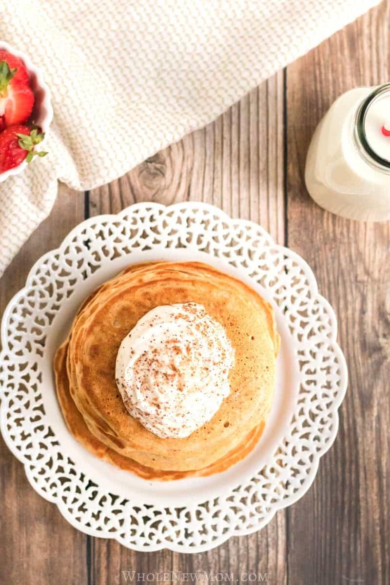 gluten-free eggnog pancakes on a white plate