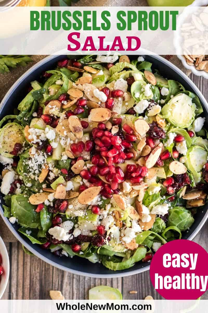 shaved brussels sprout salad with pomegranate seeds in white bowl