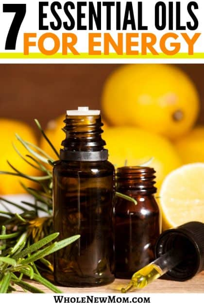 amber essential oils bottles with lemons and rosemary in the background for Essential Oils for Energy post